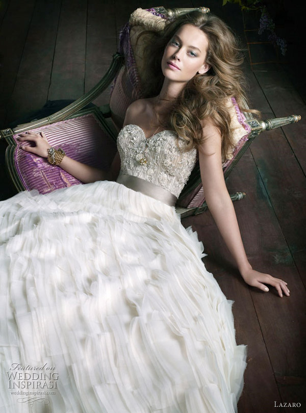 Lazaro Wedding Gown Fall 2010 - 2011 collection: Ivory organza tufted ball bridal gown, sweetheart neckline, sheer jewel encrusted bodice with platinum silk satin ribbon at natural waist, tufted organza A-Line skirt, chapel train.