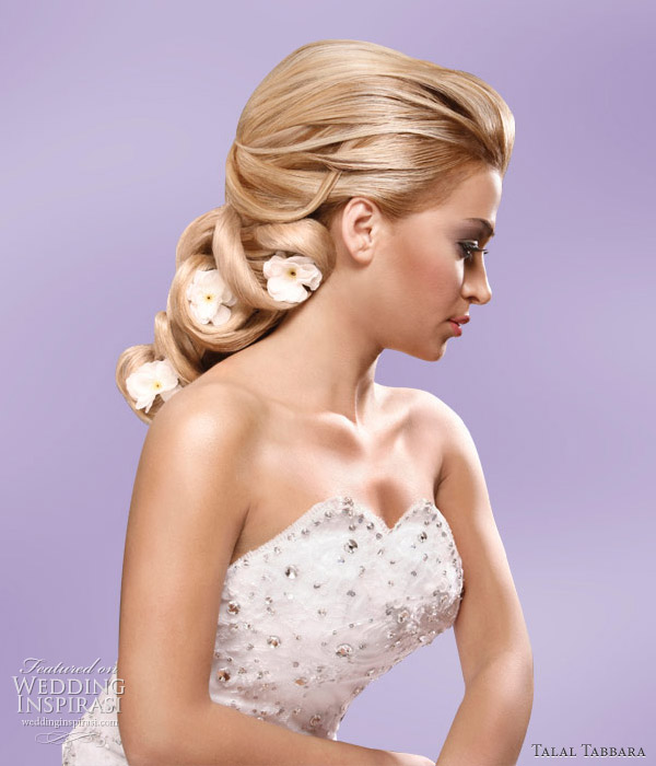 Soft romantic wedding hairstyle, accessorized with flowers, by makeup artist and hair stylist Talal Tabbara