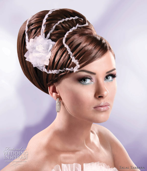 Wedding updo - this elegant look is suitable for brides going for the traditional, Princess or Fairytale romance look