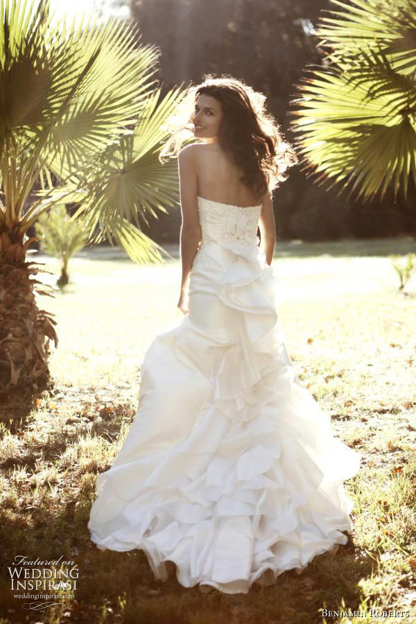 Benjamin Roberts wedding gown 2011 - 'Spanish' effect flamenco train contrasts with the plain taffeta A line front on this sweetheart, strapless gown.