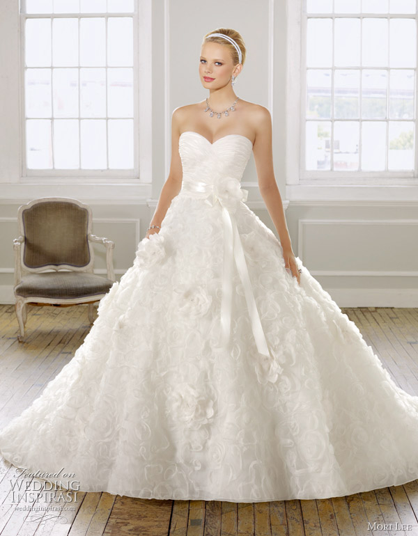 Above very pretty organza wedding dress with floral design ribbon waist