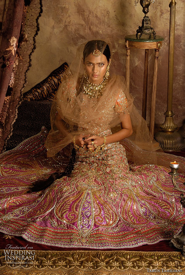 Indian wedding fashion - bridal ghagra choli or lehenga in orange and pink embroidered with sequins and white and multicolor kundan stones