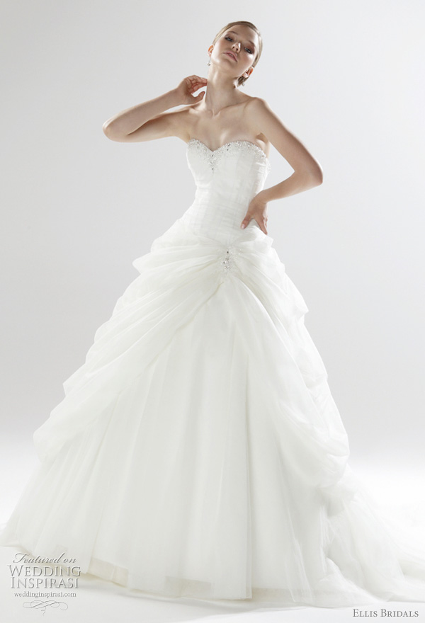 2011 tulle and taffeta wedding ball gown featuring illusion boned corset wrapped in pleated tulle with a voluminous draped skirt and crystal embellishment. From Ellis Bridal UK