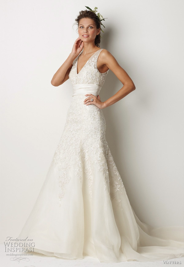 "Watters Fall 2011 bridal collection - Sterling wedding dress:Ivory washed silk organza v-neck, fluted hem gown with ivory silk taffeta embroidery on bodice, skirt and solid ivory silk taffeta midriff. Gown is embroidered with vintage floral motifs using cotton thread, french knots, crystals, ivory silk taffeta strips and has a 73"" Cathedral train."