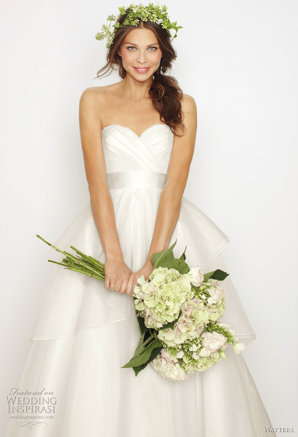"2011 Watters bridal collection - Swan wedding dress: White silk organza sculpted strapless gown with layered cascading over skirt and snow double faced ribbon at waist. Dress features hand rolled white silk organza flower corsage at small of the back and 60"" Sweep train. The ribbon is available in Gardenia, Vanilla Bean, and Seaside."