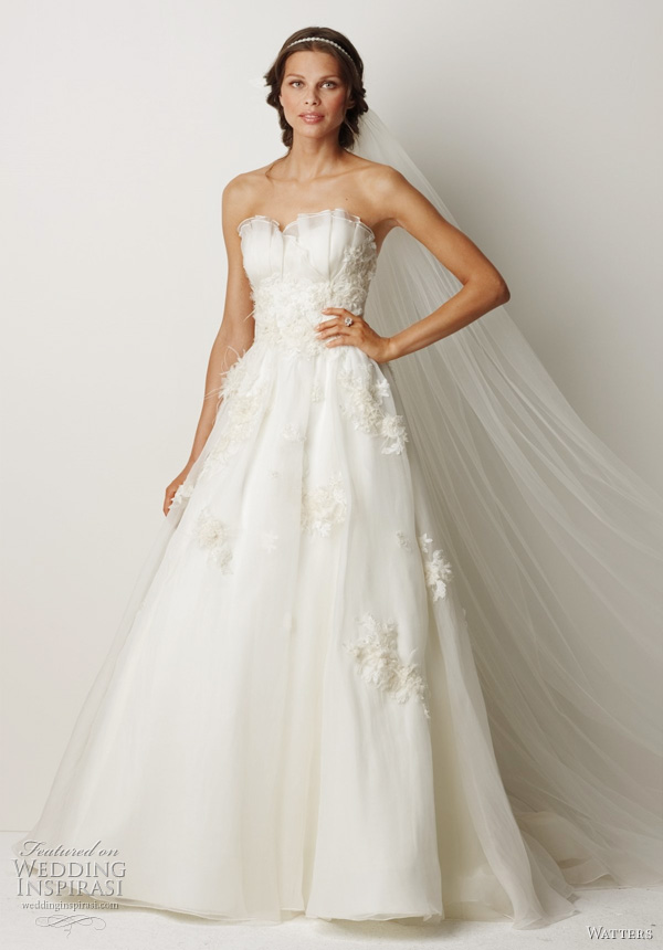 2011 wedding dress from Watters fall bridal collection - Cairns- Ivory washed silk organza ball gown with sheer sweet crumb neckline, beaded and embroidered ivory lace midriffs and traversing skirt. Lace motifs are embellished with crystals, organza and ostrich feathers, and features a 69 inch Chapel train.