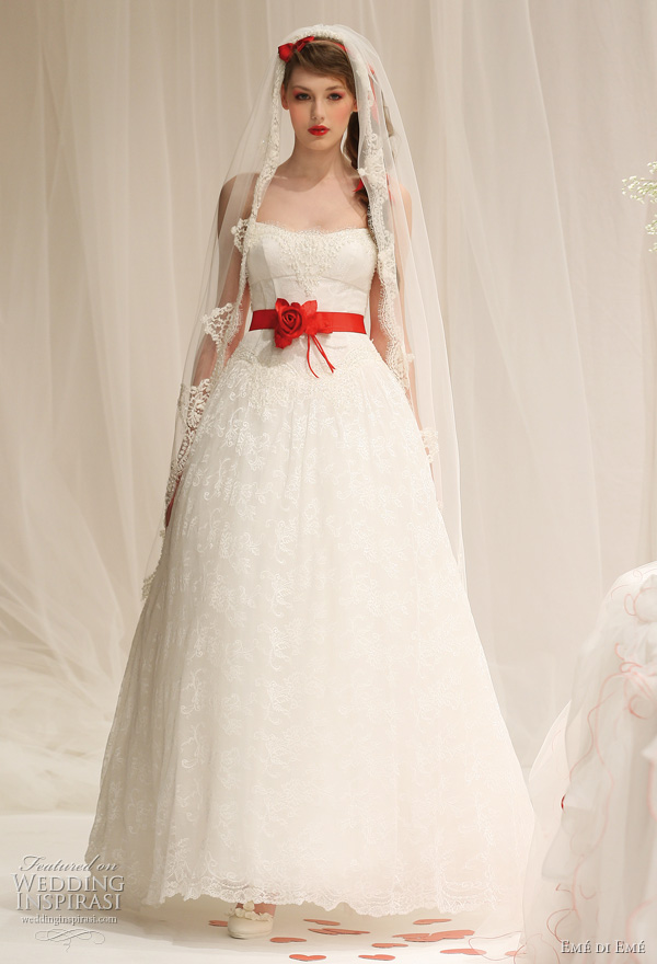 Emé di Emé 2011 bridal collection - white wedding dress with red sash belt, shown with veil