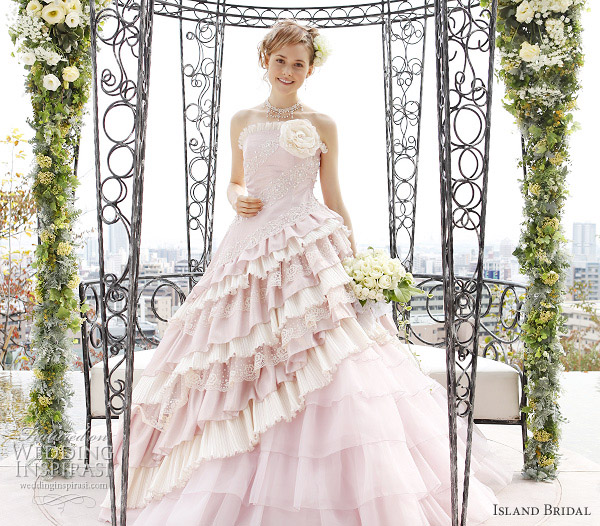 Baby pink strapless wedding gown with asymmetical ruffles