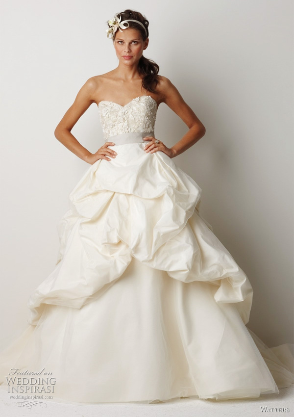 "Watters 2011 wedding dress collection - Belmont Ivory silk taffeta sculpted strapless ball gown with vintage lace inspired beading and embroidery on bodice. Bodice and skirt have subtle ivory tulle overlay, oyster grosgrain ribbon at waist, top skirt is fully bustled, with a 65"" chapel train."