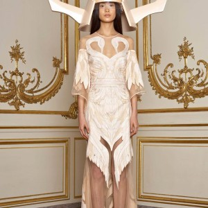 Givenchy Spring 2011 couture collection by Ricardo Tisci - model with beige dress and horned helmet