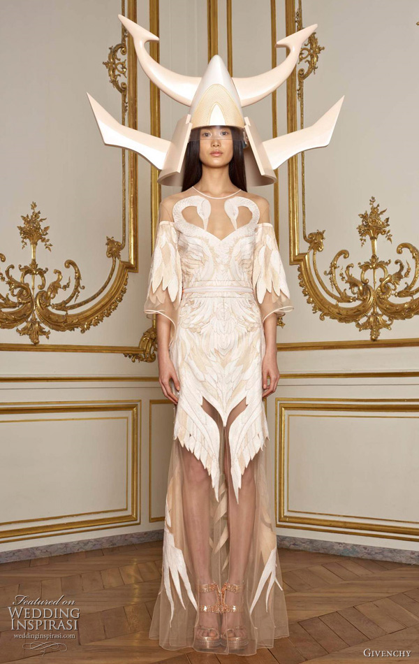 Givenchy Spring 2011 couture collection by Riccardo Tisci - model with beige dress and horned helmet