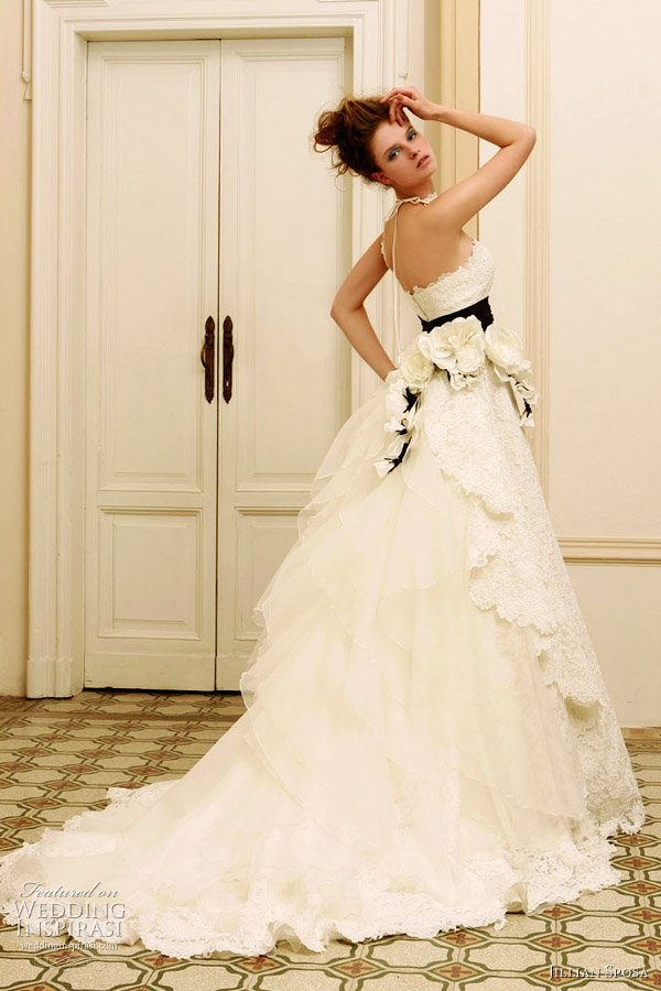 The back of this dress with black sash is stunning White wedding gown by