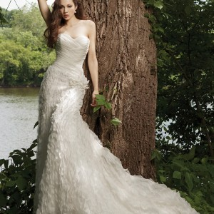 Spring 2011 wedding dress by Kathy Ireland 2be bridals - style G231120 Strapless crinkled chiffon sheath with sweetheart neckline, directionally ruched bodice, asymmetrically dropped waistline accented with hand-crafted flower, skirt with elaborately detailed accent. Removable straps included.