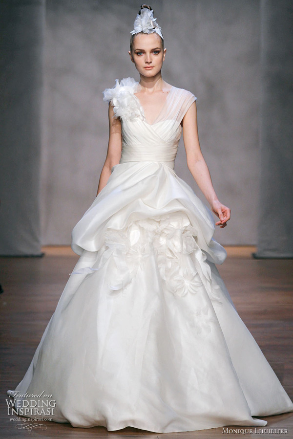 Monique Lhuillier wedding gown, Fall 2011: Bailey - Ivory sheer silk organza asymmetric draped bodice gown with hand tufted skirt and floaral bouquet accents