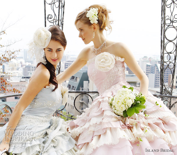 Baby blue and pink wedding dresses from Island Bridal - strapless style with ruffle skirt