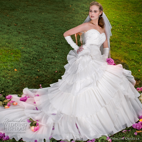 Princess Ornella 2011 bridal collection - strapless white wedding gown, worn with gloves and veil