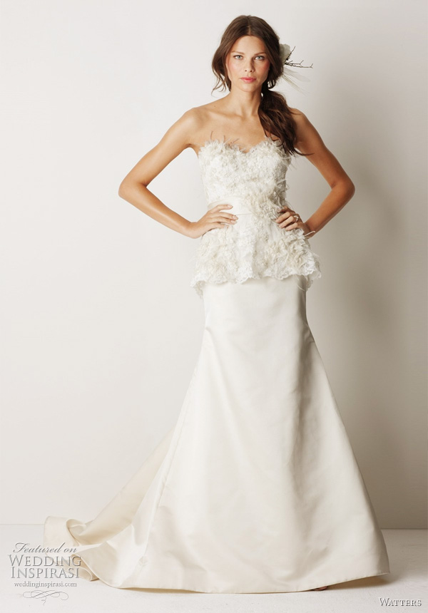 "Watters Fall 2011 wedding gowns - Grafton Eggshell duchess silk satin sculpted neckline gown with ivory lace overlayed bodice and sheer lace peplum. Lace is embellished with ivory organza flowers, ostrich feathers and crystals. Dress has a 58"" Sweep train."