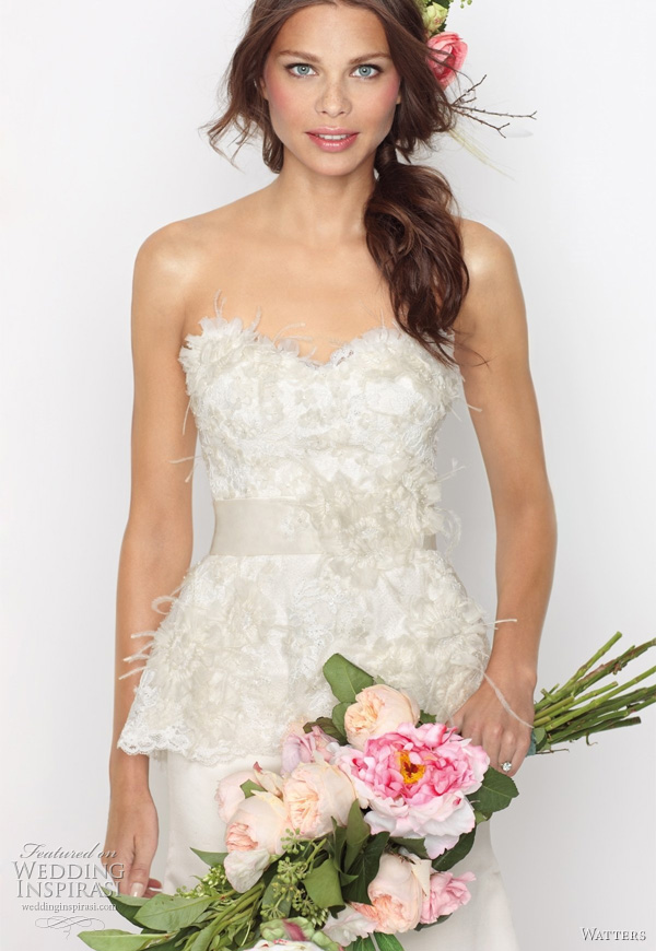 "Grafton wedding dress from Watters Fall 2011 bridal collection -  Eggshell duchess silk satin sculpted neckline gown with ivory lace overlayed bodice and sheer lace peplum. Lace is embellished with ivory organza flowers, ostrich feathers and crystals. Dress has a 58"" Sweep train."
