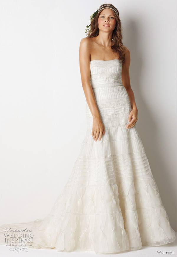 "Watters Fall 2011 bridal collection relaxed glamour wedding dress  -  Mackay Ivory silk organza strapless, fluted silhouette gown with pin tucks, beading and cotton lace bands traversing the body of the dress and 72"" chapel train."