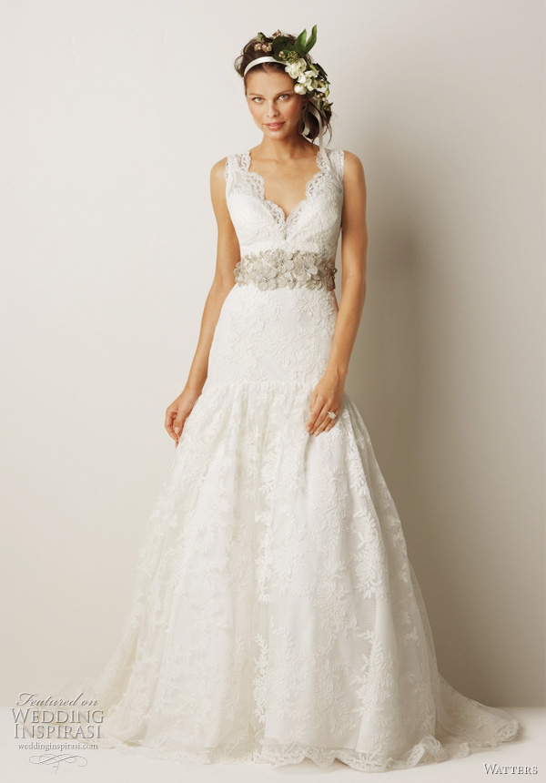 "Watters bridal Fall 2011 collection wedding dress  -  Lithgow Ivory v-neck antique rose patterned, re-embroidered lace mermaid gown with full flounce at hip, and 69"" chapel train. Shown with belt style 8003B (sold separately)."