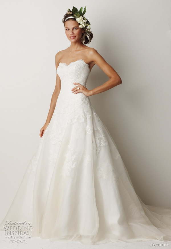 "2011 wedding dress  from Watters bridal collection -  Devenport Ivory re-embroidered lace and washed silk organza gown with full A-line skirt and veiled lace motifs on skirt. Dress has a 71"" train."