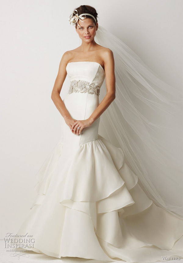 "Watters Bridal Fall 2011 collection - Canberra Ivory silk gazar sculpted strapless gown with fit and flare silhouette and dramatic layered ruffle back skirt, 62"" sweep train. Shown with belt style 8003B (sold separately)."