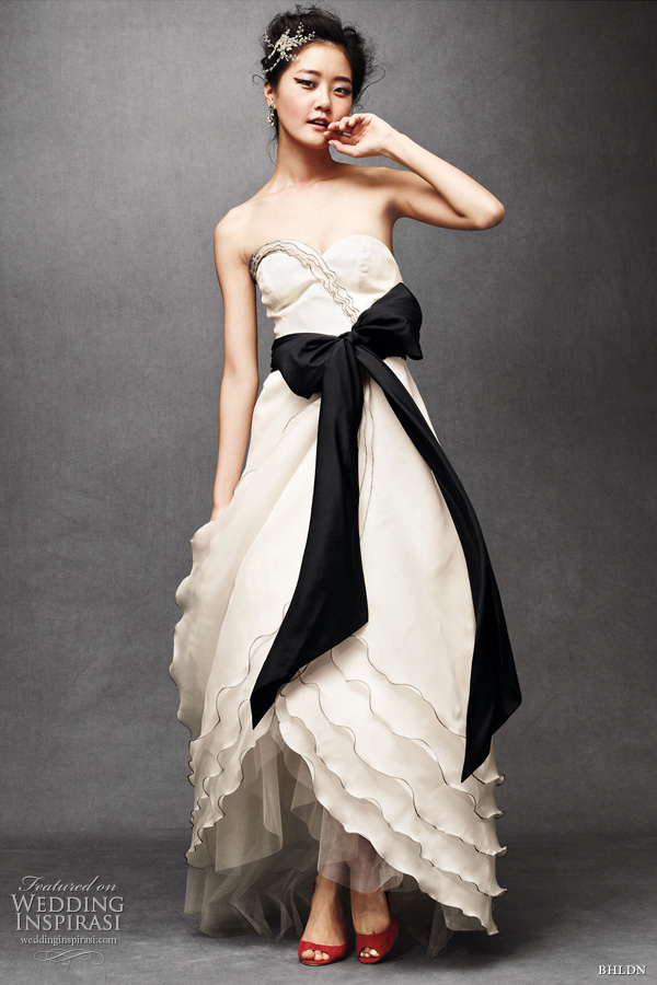 bhldn wedding - tiered tulip bridal gown in buttercream with black sash