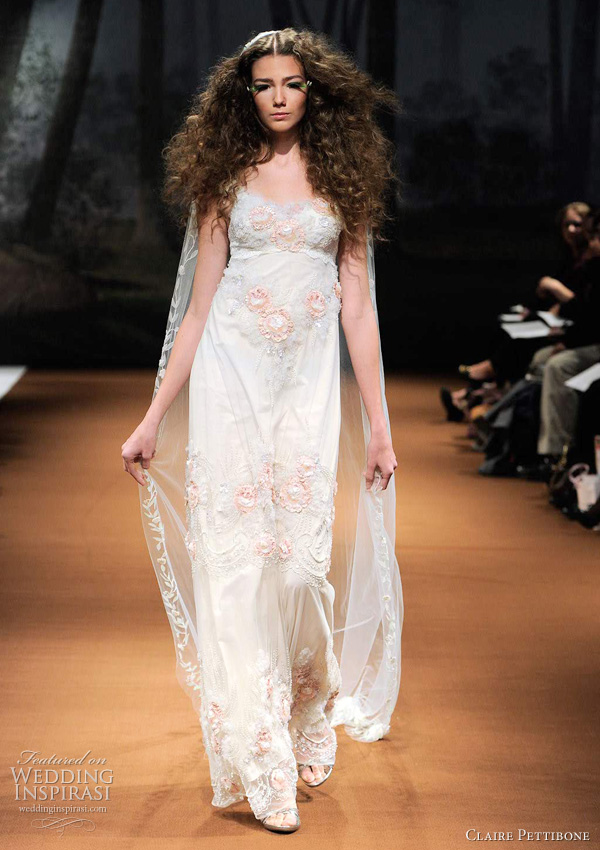 empire wedding dresses 2011 - Claire Pettibone RHOSWEN Empire silhouette with soft pink flowers and ivory tulle embellishments.