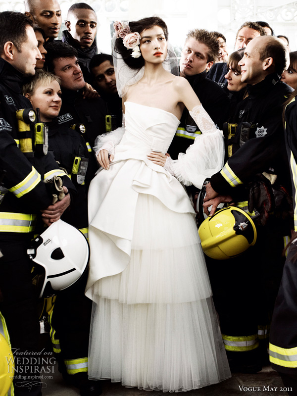 alberta ferreti wedding dress vogue - model Sun Fei Fei in silk radzimir and tulle Alberta Ferreti wedding dress surrounded by London firefighters shot by photographer Mario Testino for British Vogue Royal Wedding Issue May 2011