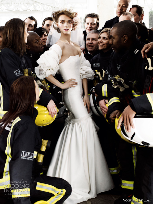carolina herrera wedding dress - model Arizona Muse in silk mikado bustier gown with draped organza applique and threadwork embroidery and organza bolero both from Carolina Herrera, surrounded by London firefighters, shot by Mario Testino for British Vogue May Royal Wedding issue May 2011