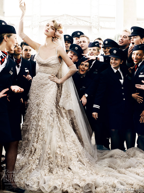 elie saab wedding dress mario testino - model Arizona Muse in an embroidered tulle and lace gown with draped bust, flower applique and grosgrain belt with tulle veil by Elie Saab haute couture, surrounded by British Airways pilots and cabin crew, shot by photographer Mario Testino for Vogue UK Royal Wedding Issue May 2011