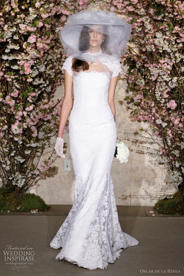 oscar de la renta spring 2012 bridal collection - wedding dress Silk faille strapless trumpet gown with corded chantilly lace overlay worn with corded chantilly lace and tulle bolero, straw wide brim hat with draped tulle and silk flowers.