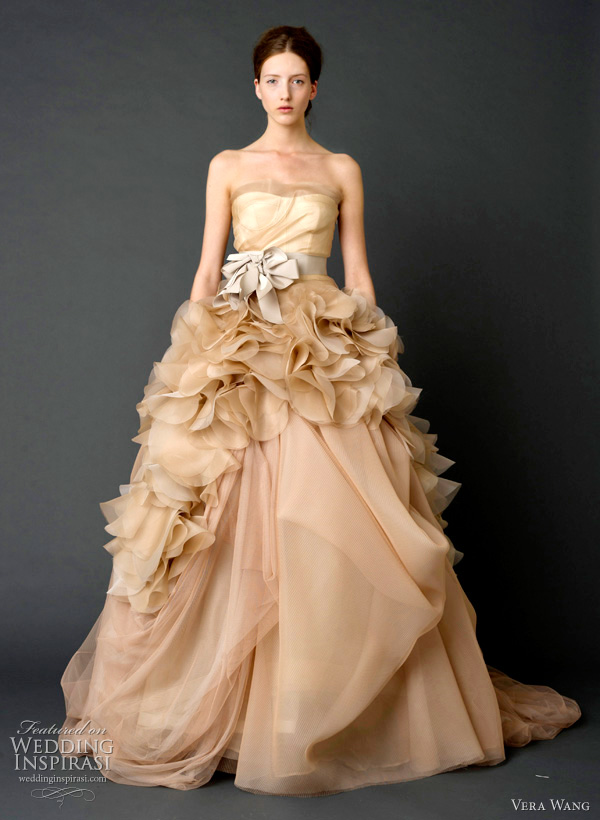 vera wang 2012 - Pale nude one-shoulder organza ballgown wedding dress with draped tulle petal detail and grosgrain multi-bow sash.