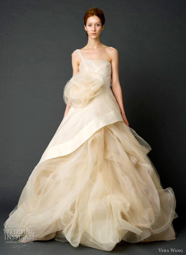 vera wang bridal spring 2012 - Sand one-shoulder gazar and French tulle ballgown with asymmetrical peplum bodice and draped skirt with tulle petal detail and horsehair and tulle corsage.