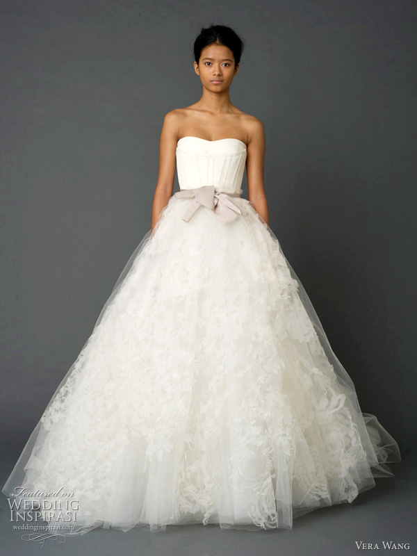vera wang spring 2012 - Strapless gown with looped petal detail on back bustle and trapunto-stitched bustier with grosgrain multi-bow sash.