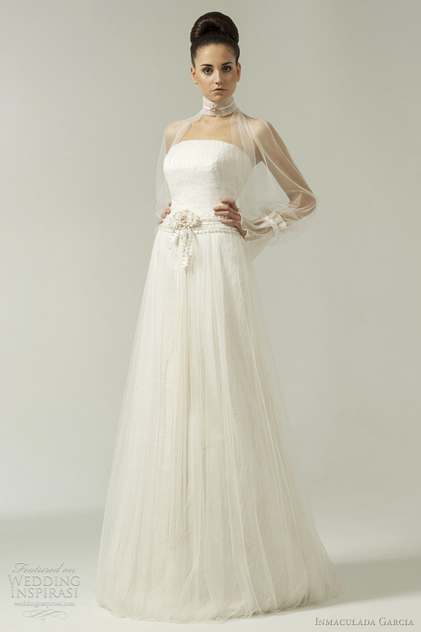 Artemisia gown featuring high collar top with sheer bell sleeves