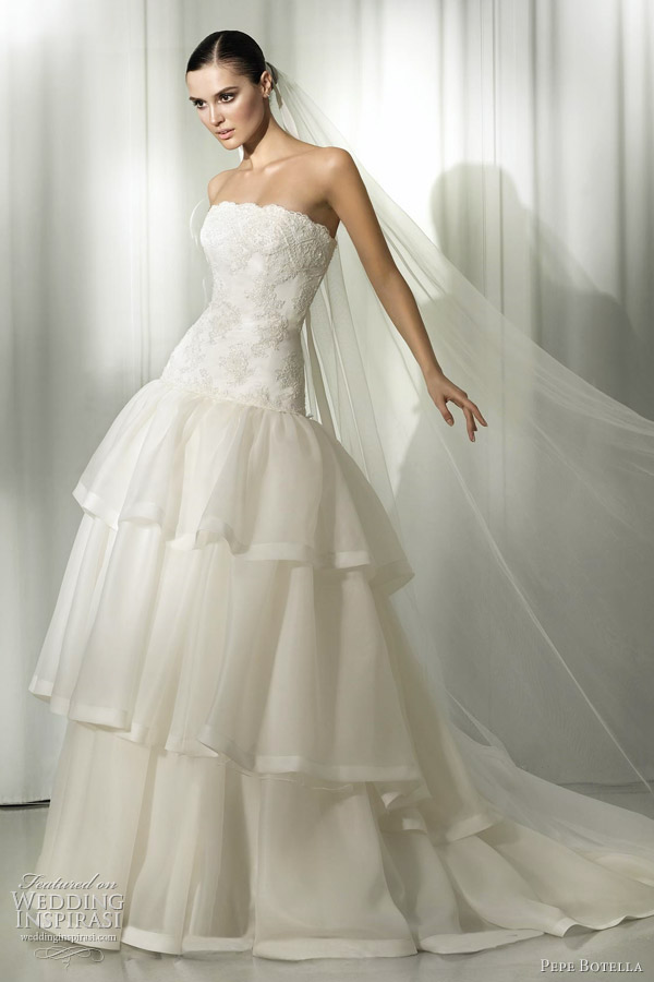 Strapless gown with lace bodice and threetier skirt pepe botella wedding