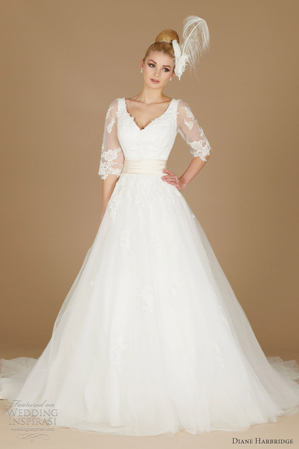 Chloe vneck gown with elbow length lace sleeves and light gold sash