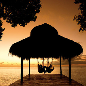 secrets resorts spas aura cozumel wedding gazebo hammock sunset romantic destination wedding