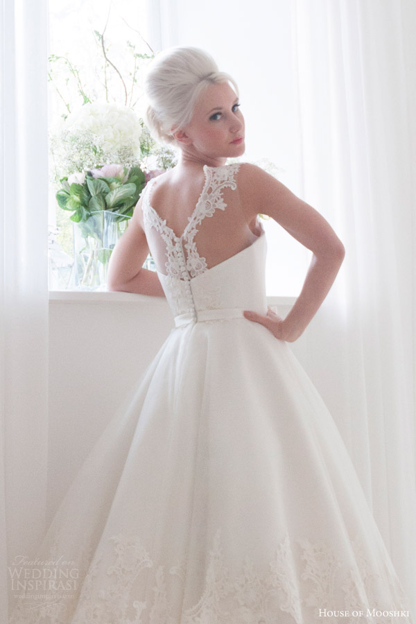 house of mooshki bridal 2016 nora sleeveless calf tea length 1950s wedding dress illusion neckline lace hem detail back view close up