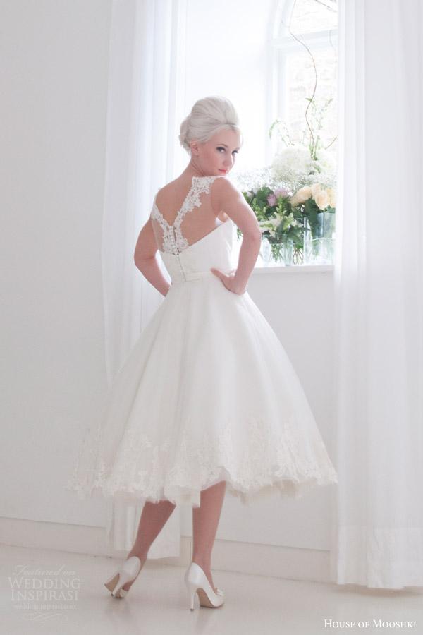 house of mooshki bridal 2016 nora sleeveless calf tea length 1950s wedding dress illusion neckline lace hem detail back view