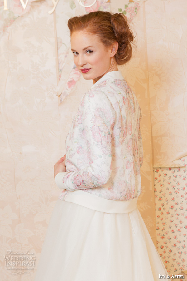ivy and aster spring 2016 bridal jewel neckline strapless topper modified a line skirt wedding dress with pockets long sleeves floral jacket closeup
