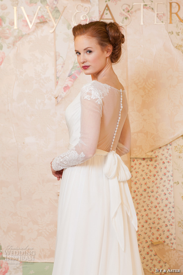 ivy and aster spring 2016 bridal v neckline sheer long sleeves lace trim modified a line wedding dress closeup