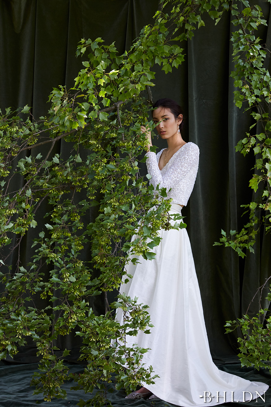 Behind the curtain bhldn s chic fall bridal collection for Long sleeve high low wedding dresses