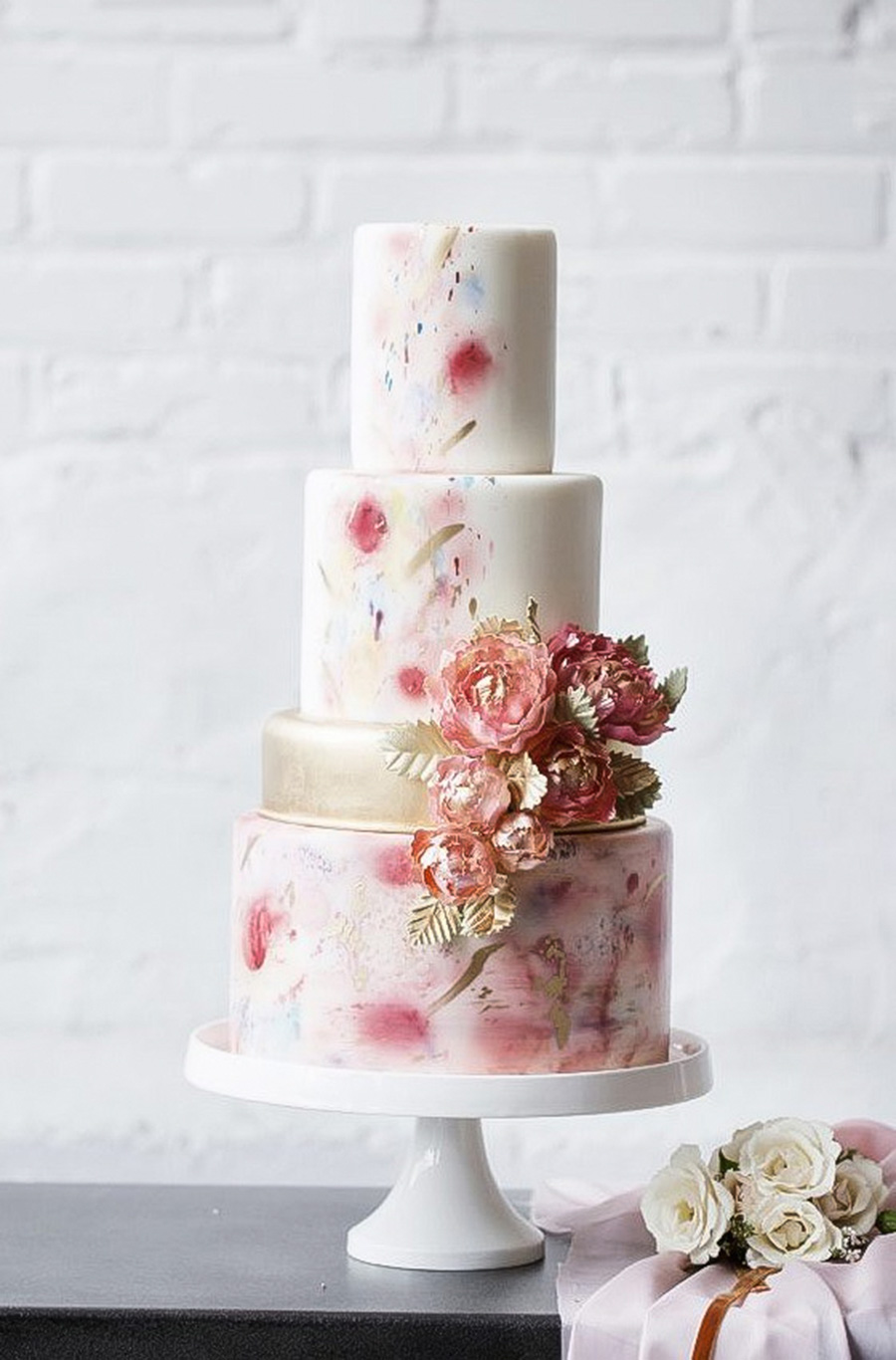 white 3 4 tier pink floral print gold accent wedding cake (14) mv