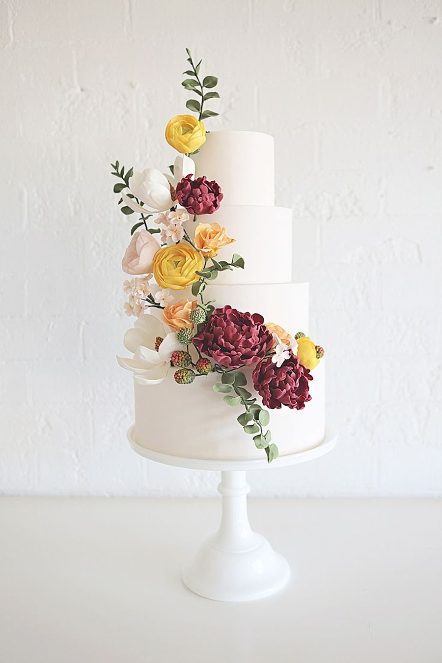 white 4 tier red yellow white cascading floral wedding cake (23) mv