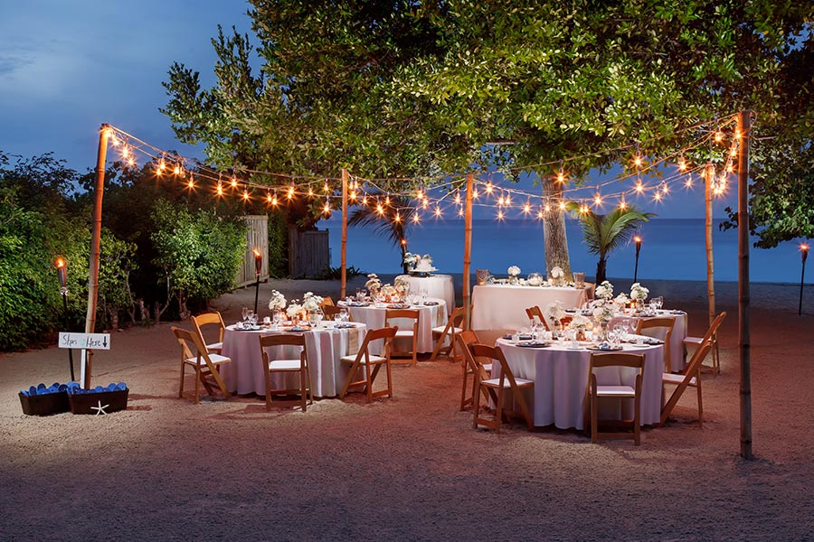 apple vacations jamaica destination wedding couples resorts negril beach night charming string light decor