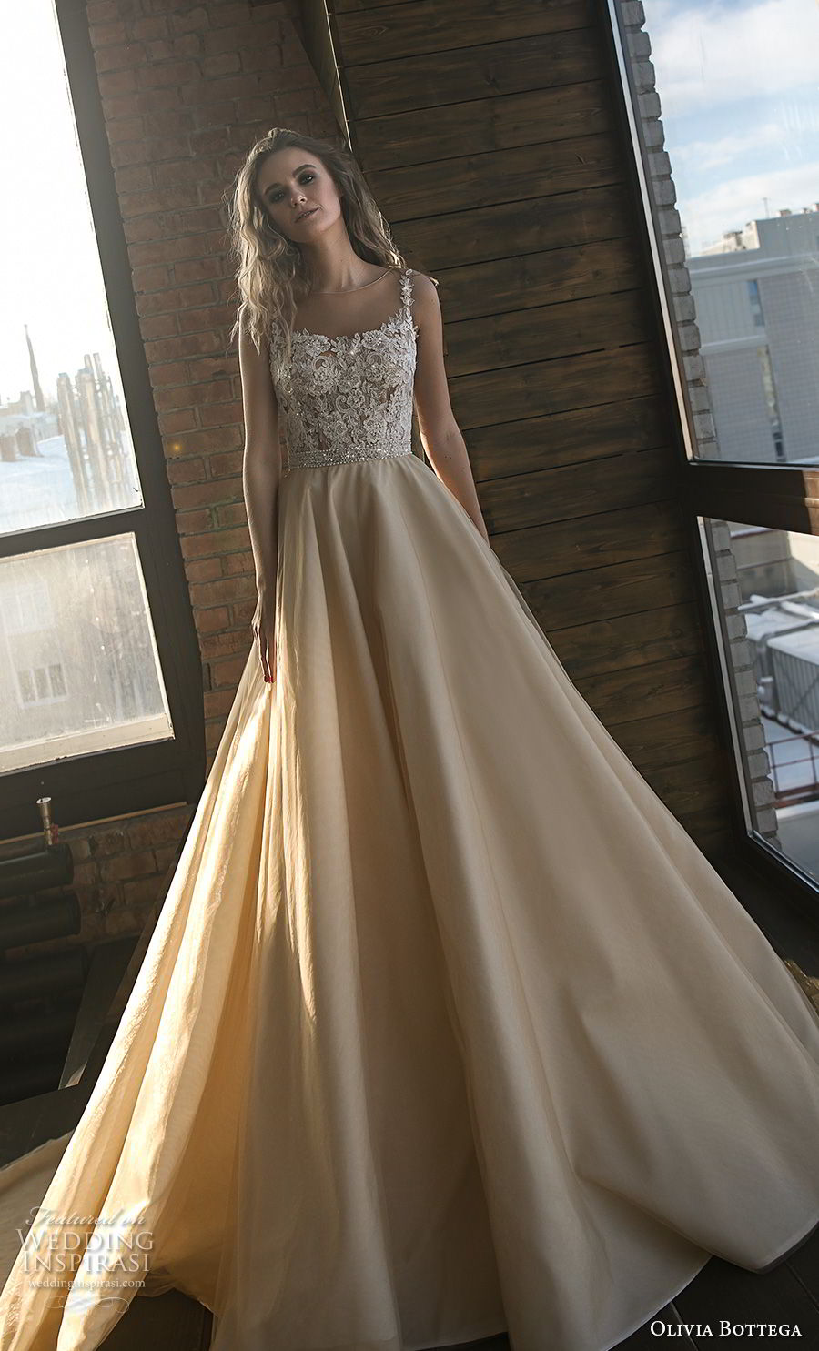 olivia bottega 2018 bridal sleeveless square neckline heavily embellished bodice romantic champagne colr a line wedding dress royal train (2) mv