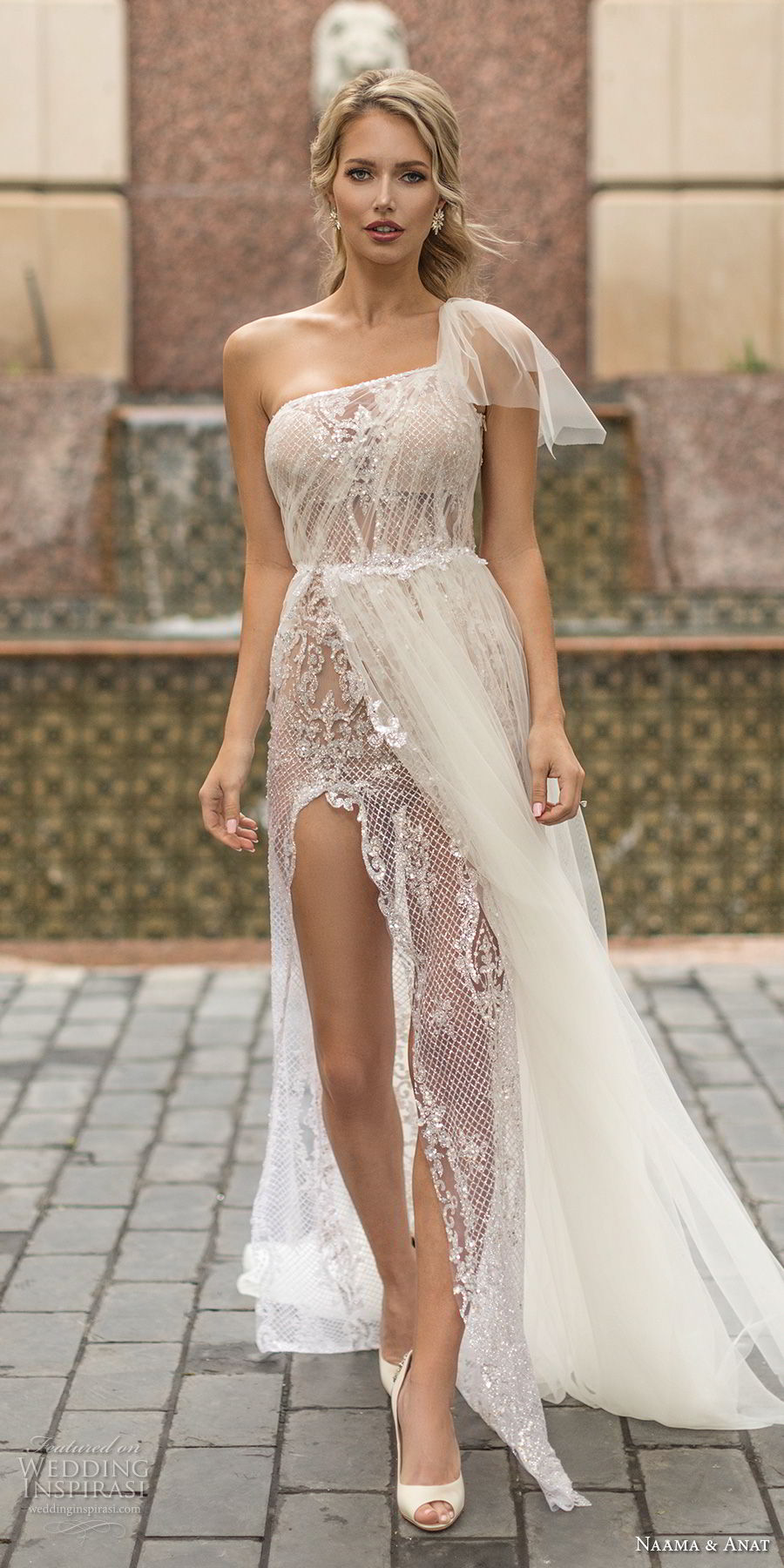 naama anat spring 2019 bridal one shoulder slope neckline full embellishment slit skirt romantic sheath wedding dress a  line overskirt sheer back chapel train (3) mv