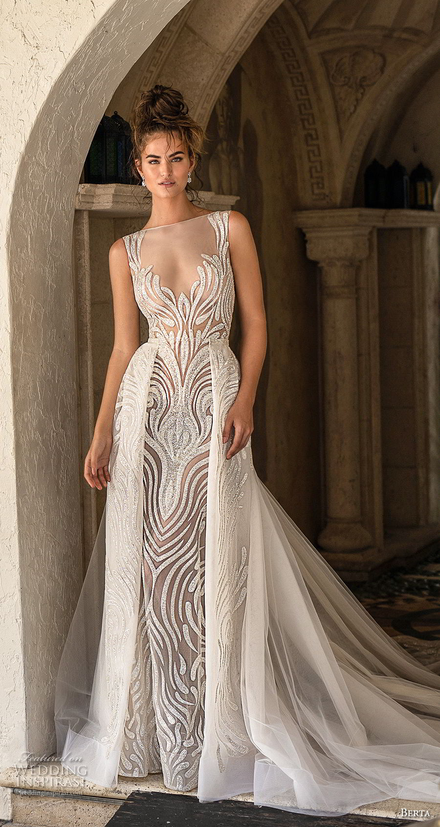 berta spring 2019 bridal sleeveless illusion bateau scoop neckline full embellishment elegant glamorous fit and flare wedding dress a  line overskirt sheer button back medium train (12) mv